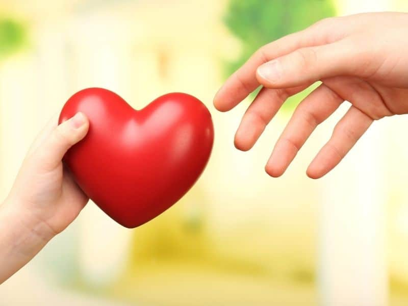 giving a heart to another person